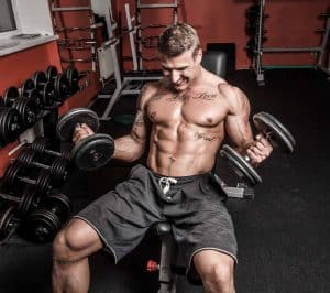Man training and having a hard workout while on anabolic diet